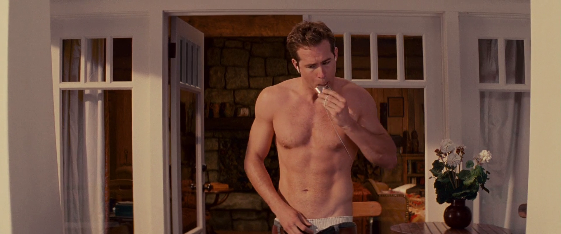 Ryan Reynolds as Andrew Paxton shirtless/naked in The Proposal