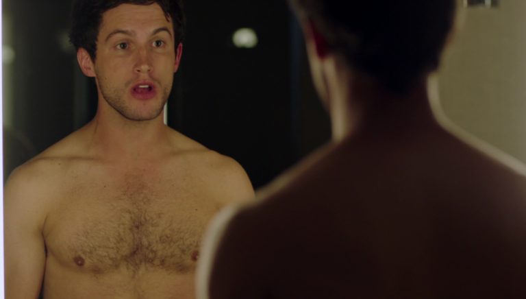 "Rob Heaps as Ezra Bloom and Parker Young as Richard shirtless in Imposters 1×02 ""My Balls, Dickhead"""