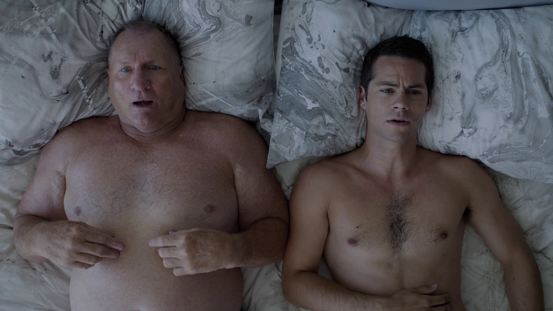 "Dylan O'Brien as Stu and Ed O'Neill as Burt shirtless in Weird City 1×01 ""The One"""